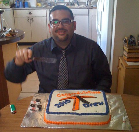 Drew celebrating his graduation from UTEP with a cake from the Texas Rose Bakery.